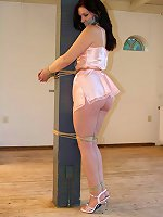 Pole-tied housewife is still wearing white babydoll dress and a set of white stockings